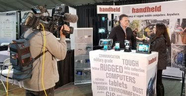 interview at handheld booth at world ag expo