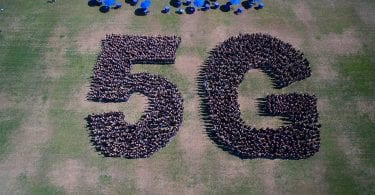 people gathered in a 5g symbol